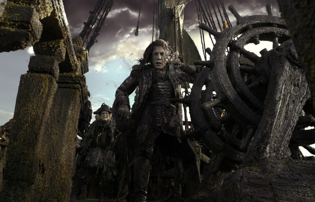 """""""PIRATES OF THE CARIBBEAN: DEAD MEN TELL NO TALES""""..The villainous Captain Salazar (Javier Bardem) pursues Jack Sparrow (Johnny Depp) as he searches for the trident used by Poseidon...Ph: Film Frame..©Disney Enterprises, Inc. All Rights Reserved."""